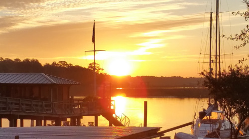 The sun rising over Isle of Hope and the Intracoastal Waterway as seen from Bluff Drive